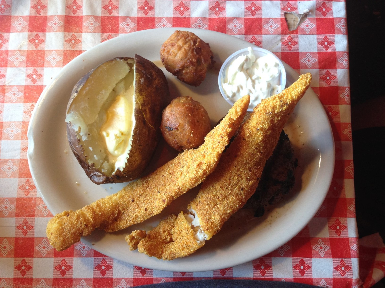 """This is my meal.  Those strips of catfish were masking a """"rare"""" sirloin steak that was cooked to medium well."""