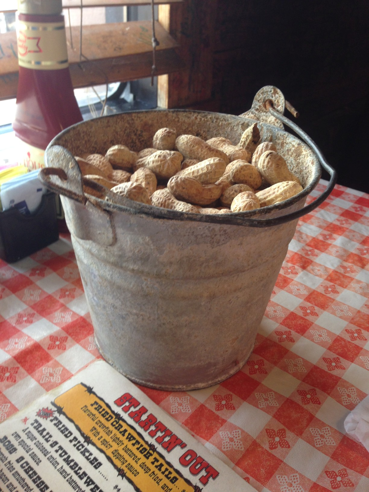 You can even eat peanuts while you wait on your food.