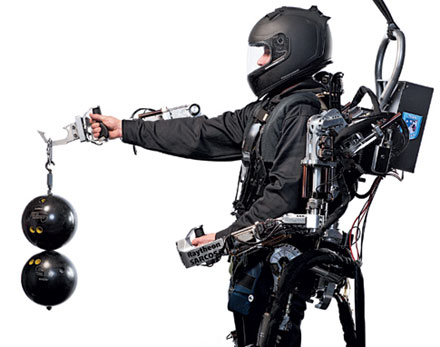 Showing off: an exoskeleton makes lifting a cinch.  Try lifting one bowling ball with your arm fully extended!