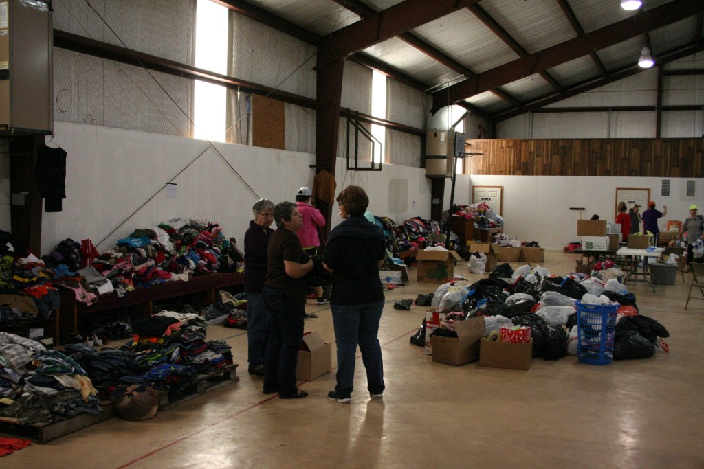 A better shot of the clothes donated. There were tables of toiletries and clothes ready for people in need to claim them. People were still bringing stuff in. I believe the center was having more stuff brought in that being taken, and eventually, they also brought in cots for people to have a place to sleep.